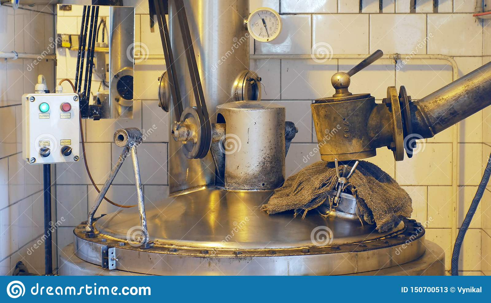 Growing distillery for the production of plum brandy by firing in a gas boiler, alembic pot still during process of