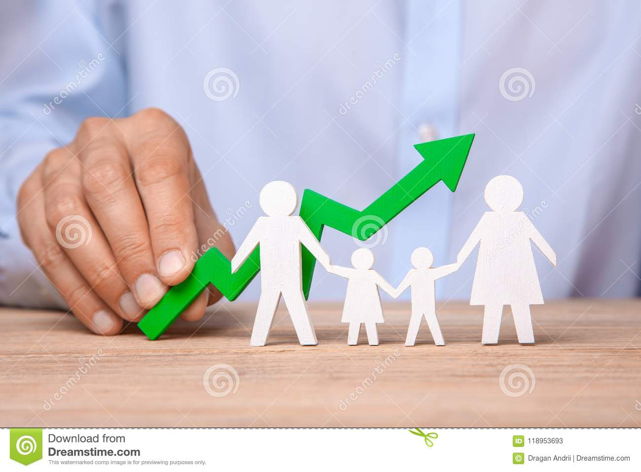 Growth of the family budget. Man holds green arrow up against the background of family