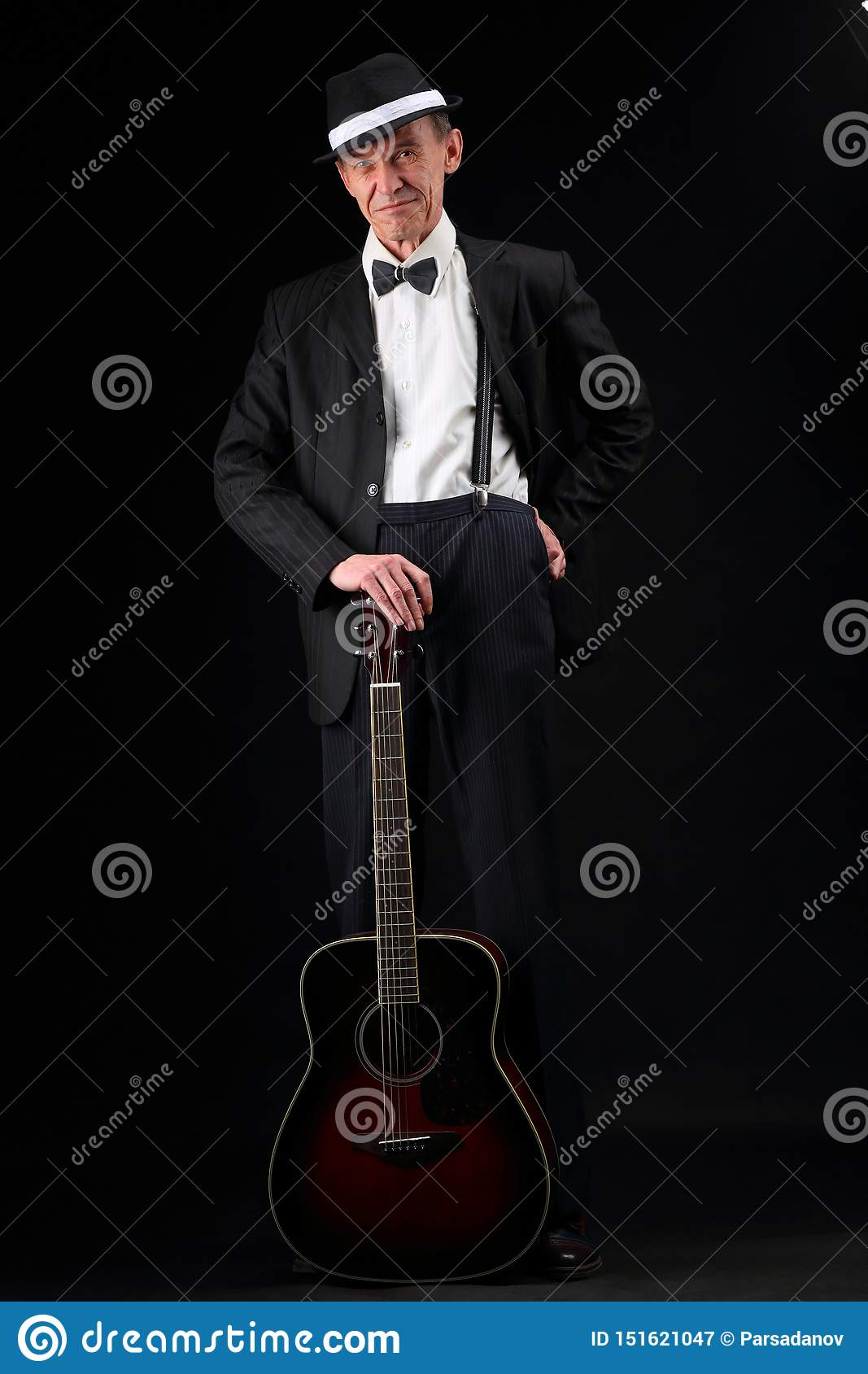 Growth portrait of an elderly musician with a guitar