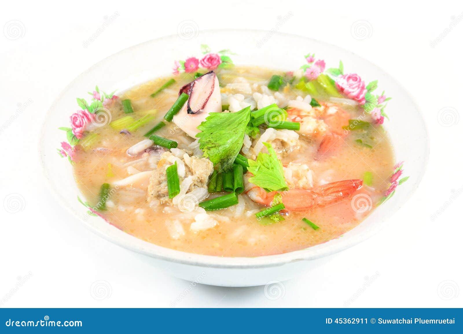 Gruau de riz avec du porc, la crevette et le squid, petit déjeuner thaïlandais
