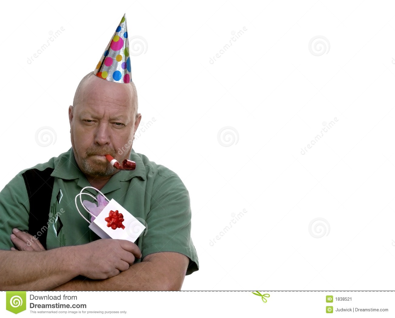 man with grumpy expression with birthday hat  t and party favor