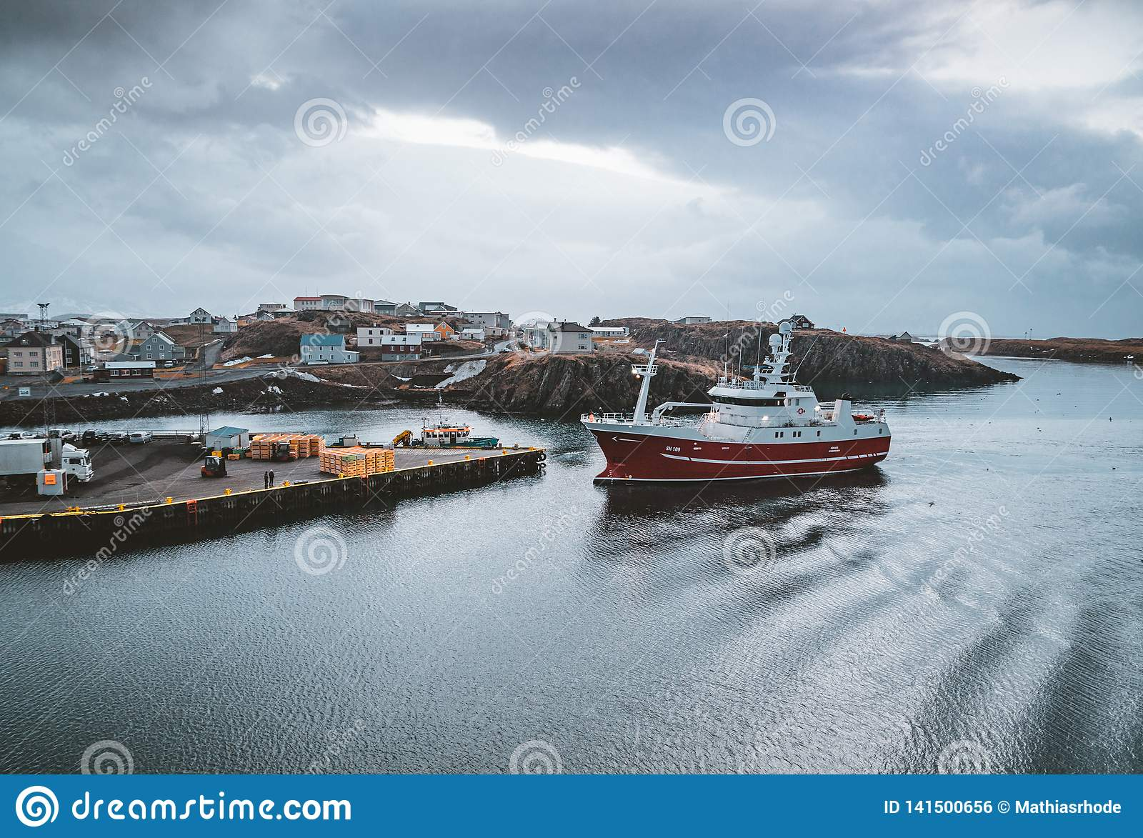 Grundarfjordur, Iceland - 03 January 2019: Harbor with motionless boats during the twilight of the afternoon, Kirkjufell