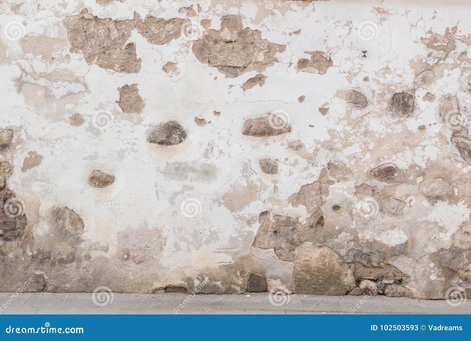 Grunge墙壁背景 老砖和石墙有明亮的被放弃的膏药的