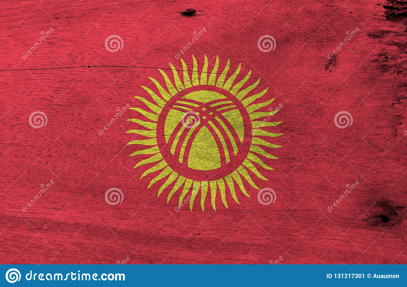 Grunge Kyrgyz flag texture, red field with a yellow sun with forty uniformly spaced rays.