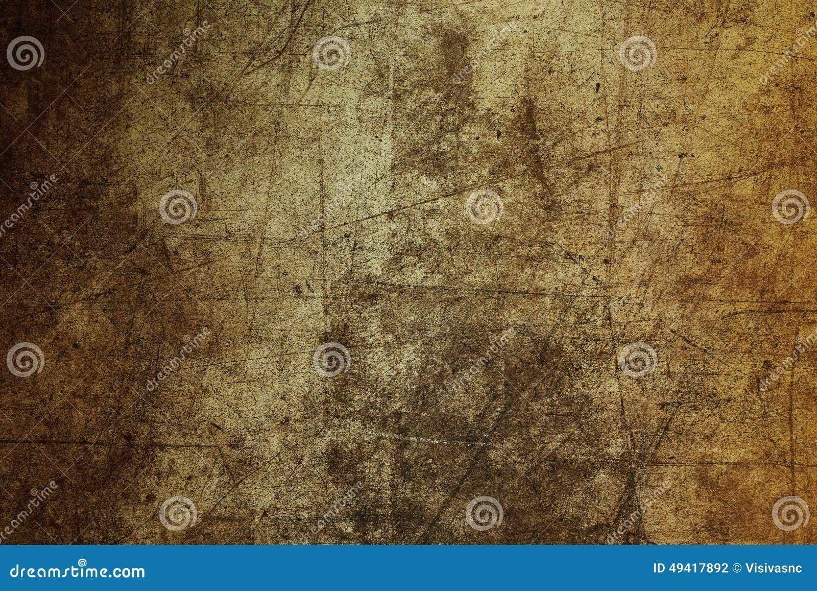 Grunge marrón del extracto de la textura de la pared del fondo arruinado rasguñado