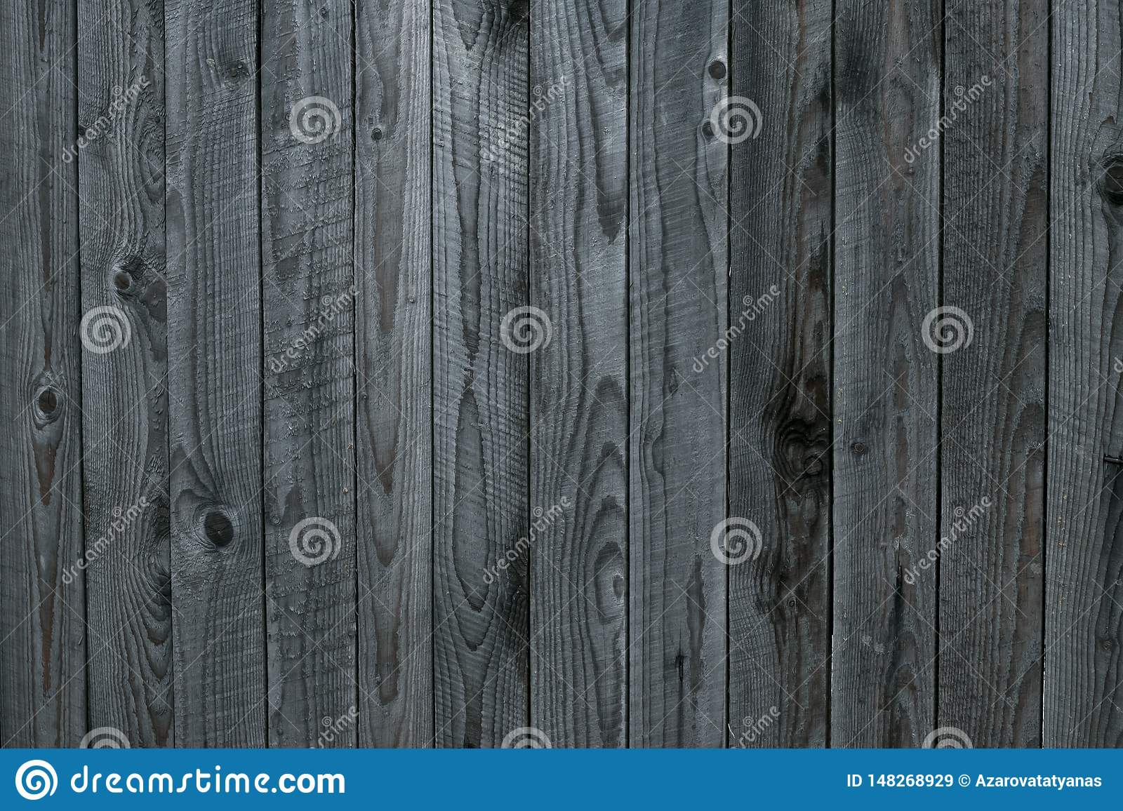 Grunge texture of gray old wooden fence. Gray background of shabby wooden boards, planks. Surface of old shabby weathered wooden p