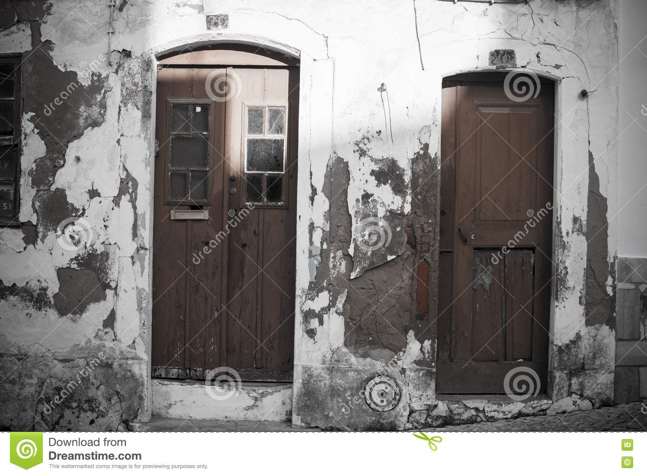 Grunge wall and doors in Mediterranean town