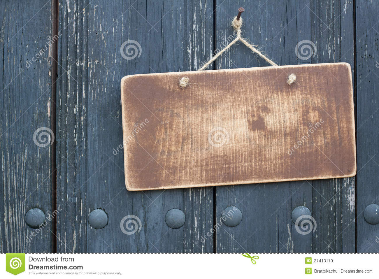 Wooden grunge signboard on planks wall background