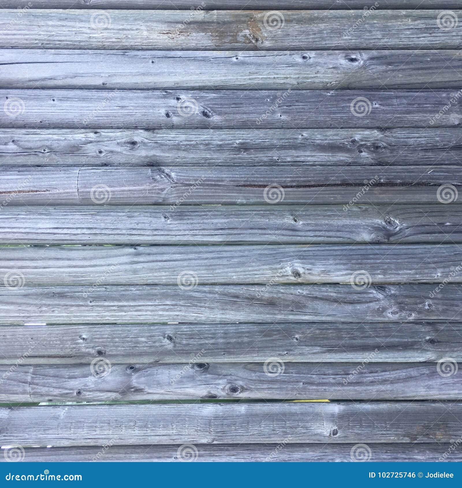 Grungy bekymrat grått trätexturerat staket