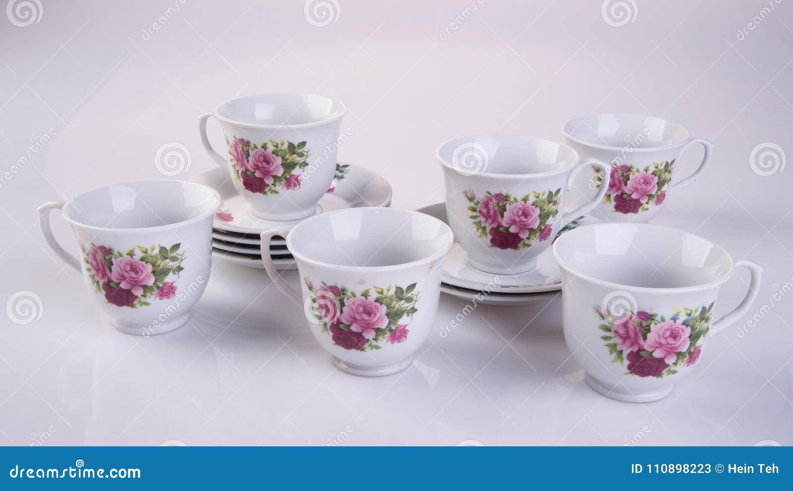 Grupo de chá ou grupo de chá da porcelana da antiguidade no fundo