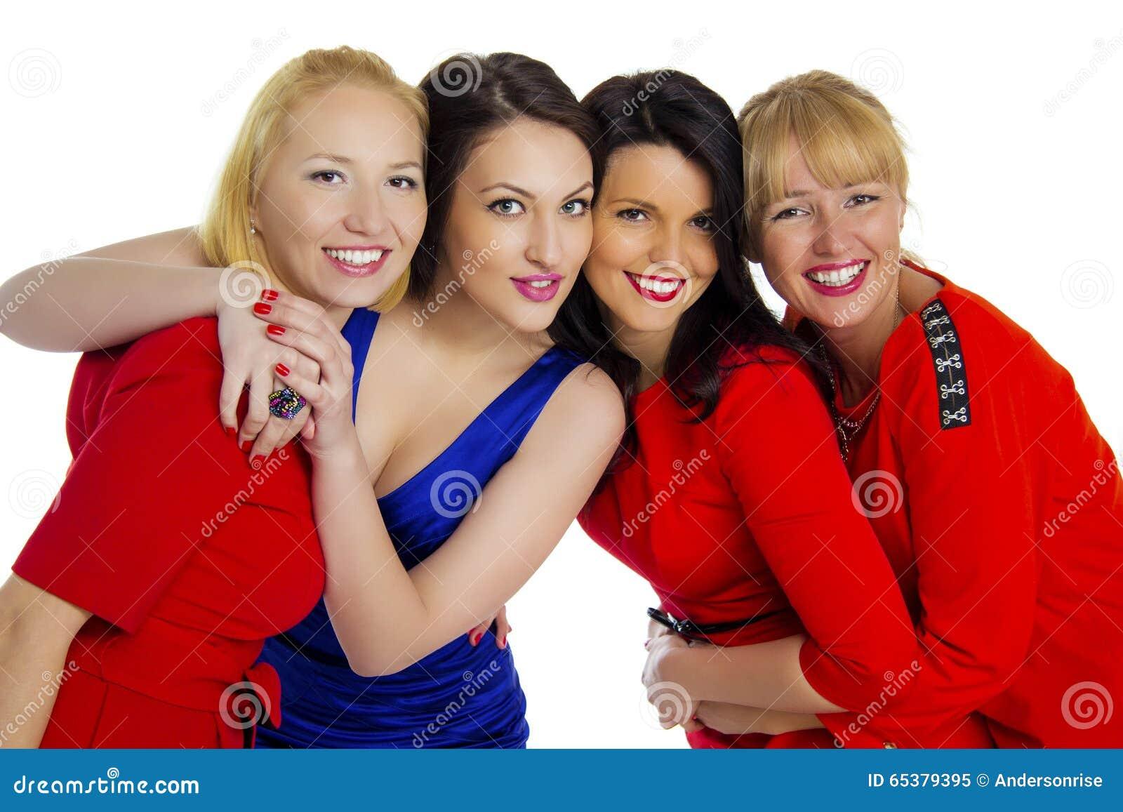 Grupo de cuatro atractivos, mujeres felices jovenes hermosas Aislado en whi