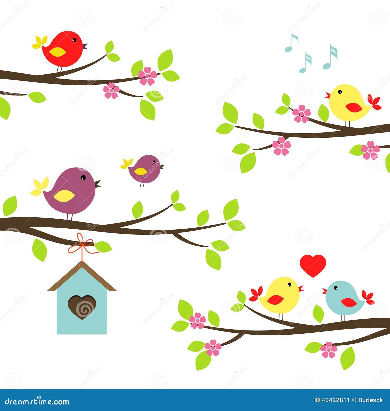 Grupo de pássaros em ramos de florescência