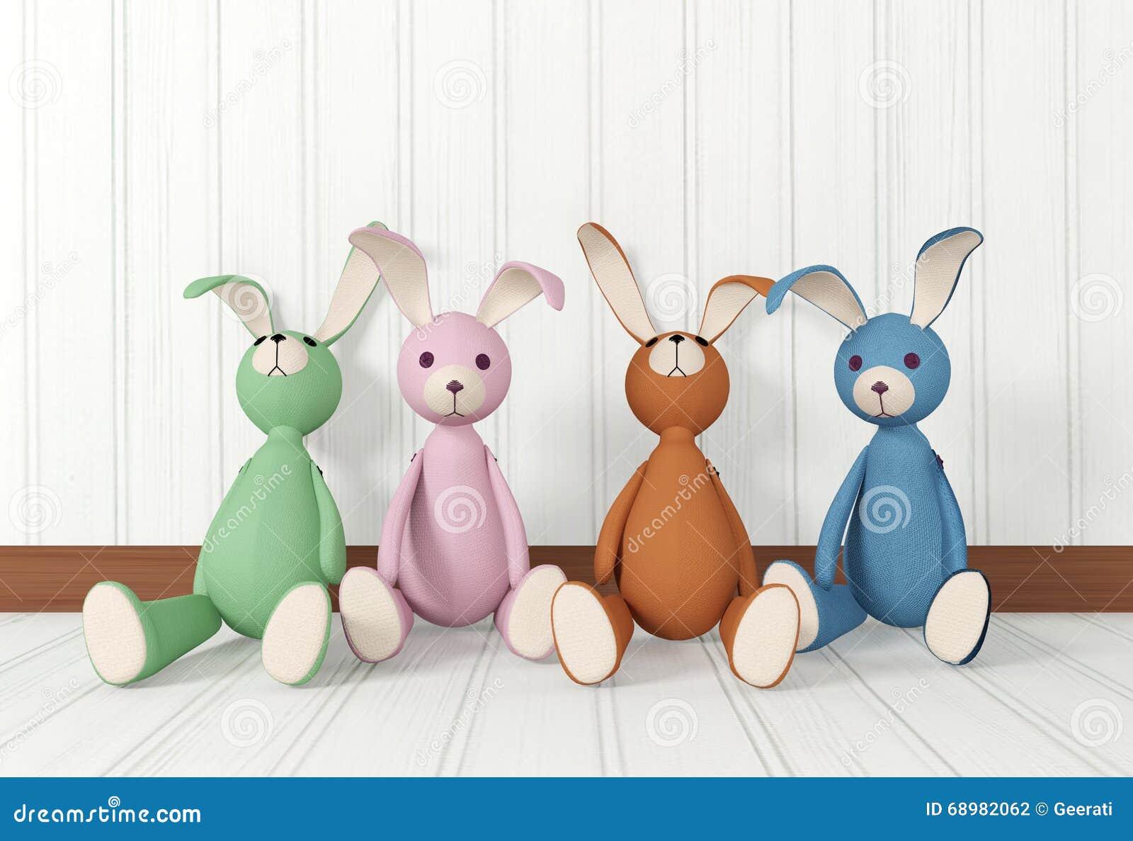 Grupo de sentarse de las muñecas del conejo