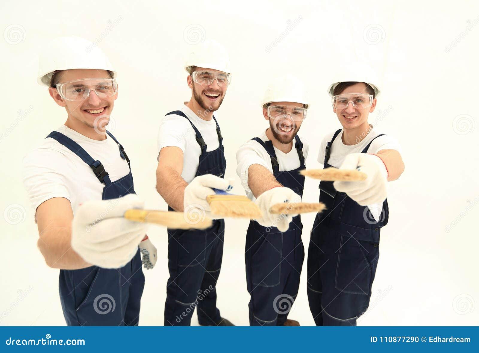 Grupo de trabalhadores da construção Isolado no branco