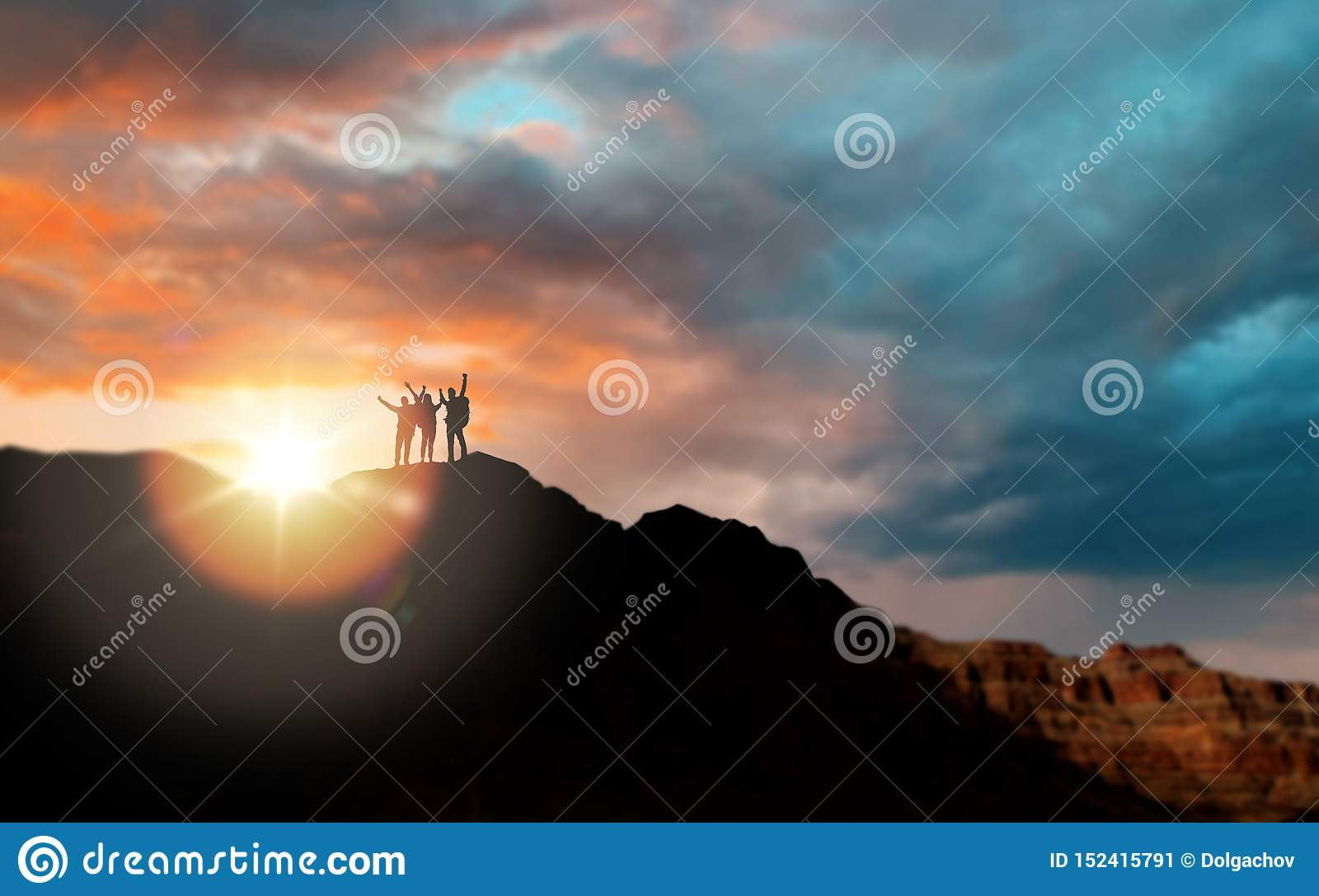 Grupp av handelsresande över solnedgång i Grand Canyon