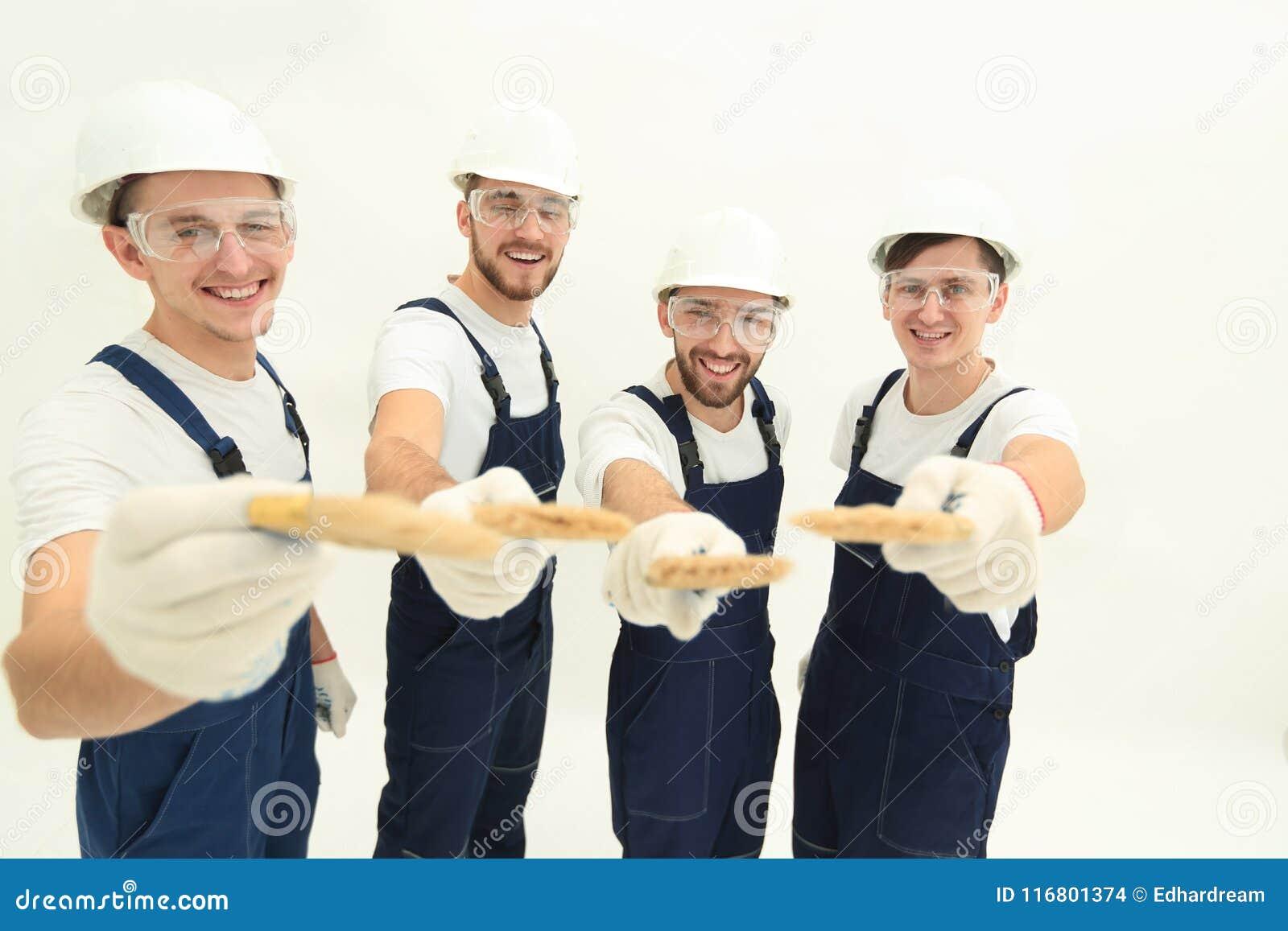 Gruppo di muratori Isolato su bianco