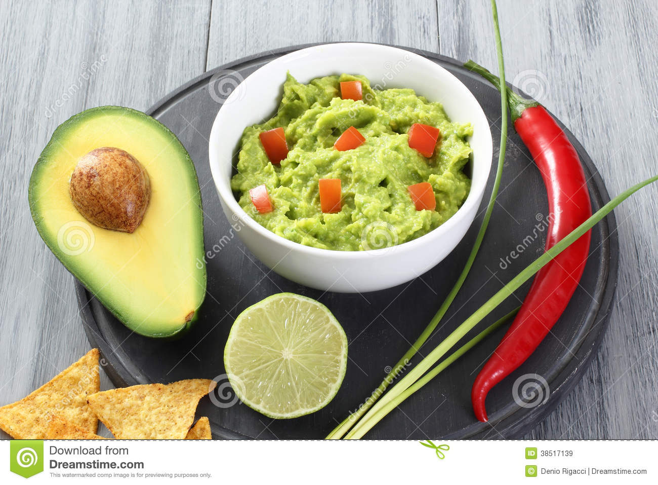 Composition guacamole salad with avocado lime and red hoto chili ...