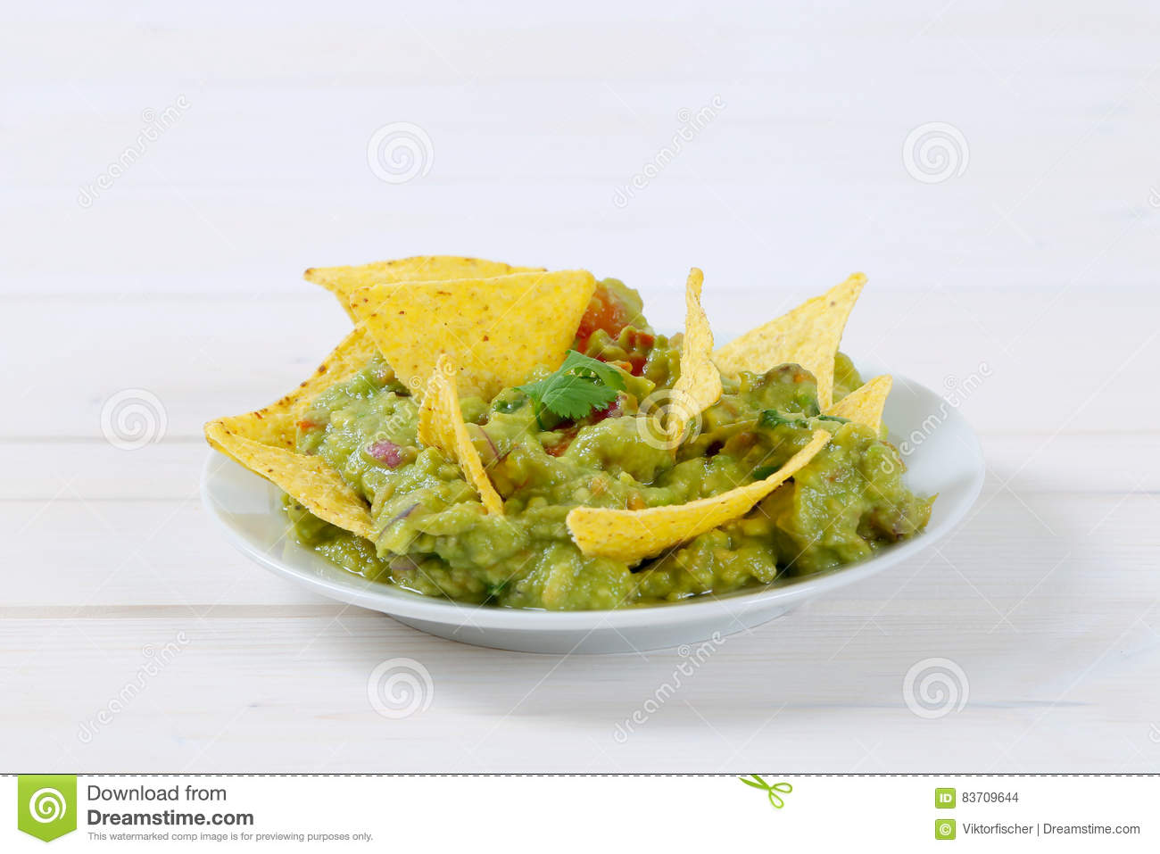 Guacamole With Tortilla Chips Stock Photo