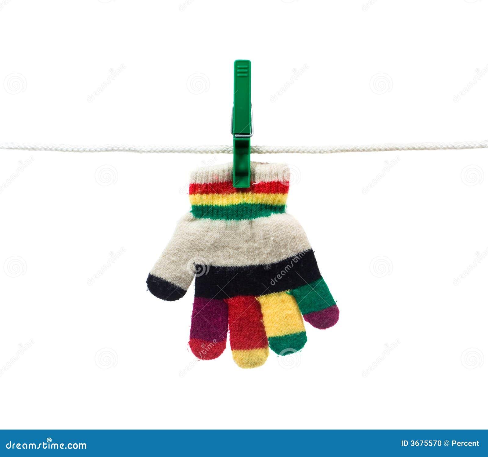 Download Guanto Di Bambino Sulla Riga Di Vestiti Fotografia Stock - Immagine di perni, inverno: 3675570