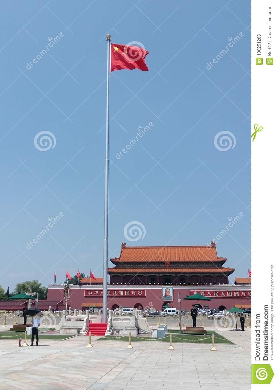 Guards around the Chinese flag at the Tiananmen square