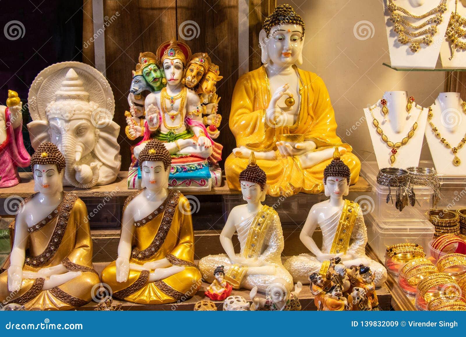 Gud buddha och gudganeshstaty