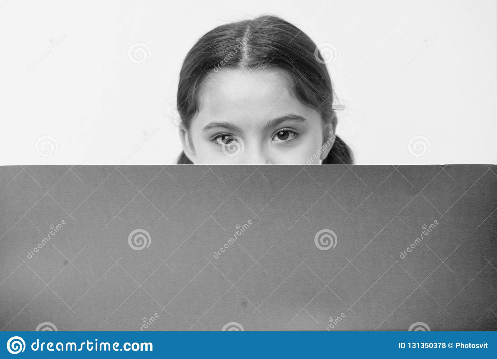 Guess what. Girl kid peeking out pink blank surface copy space. Advertisement concept. Child cute girl brunette looking