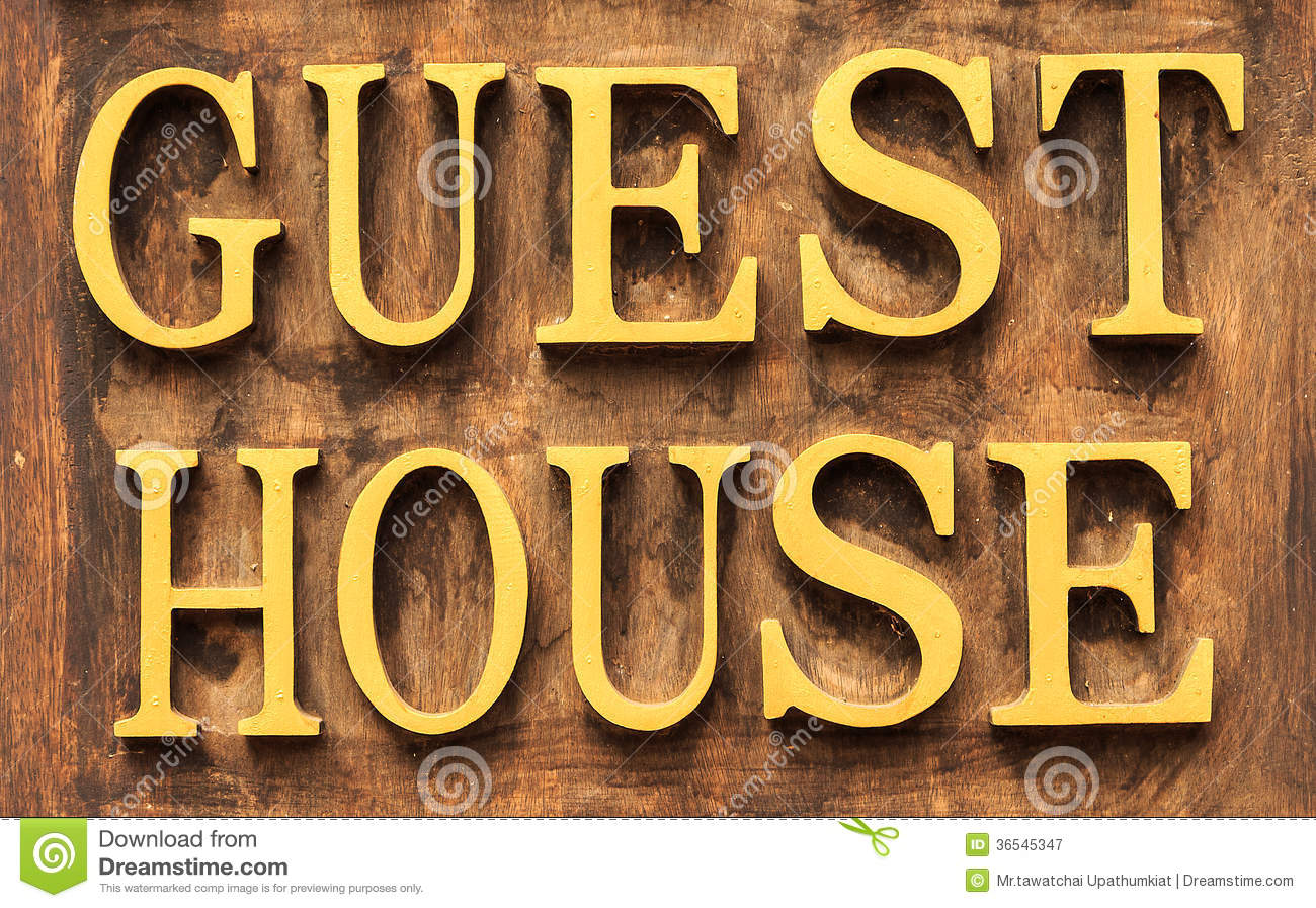 Wood Panel Sign ~ Guest house sign royalty free stock photography image