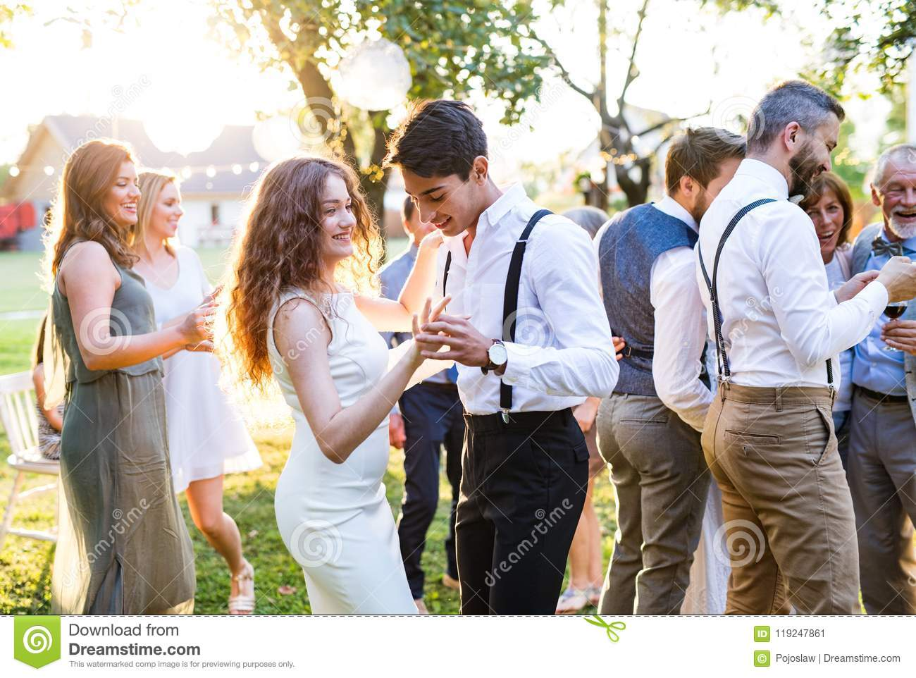 Guests Dancing At Wedding Reception Outside In The Backyard Stock