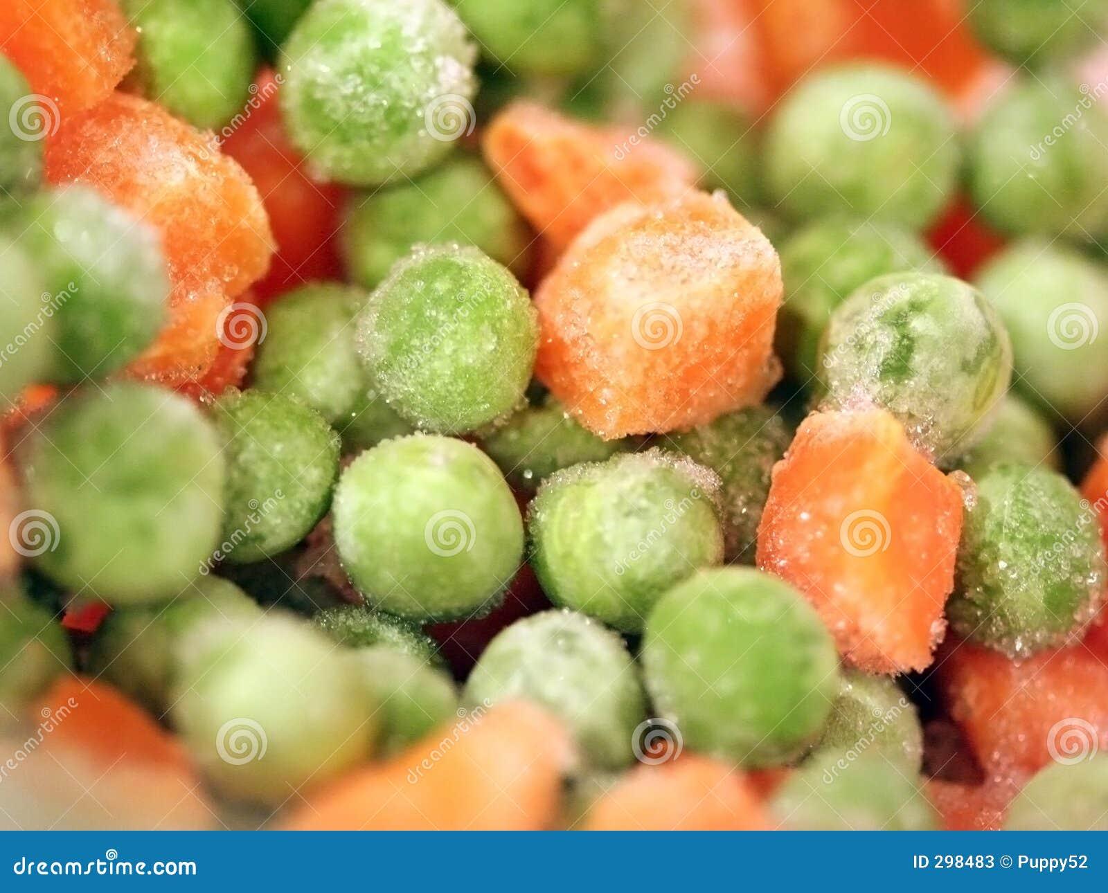 Guisantes y zanahorias congelados fotos de archivo for Cocinar guisantes congelados