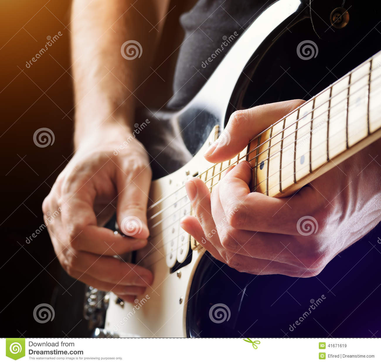 Man playing guitar on a stage