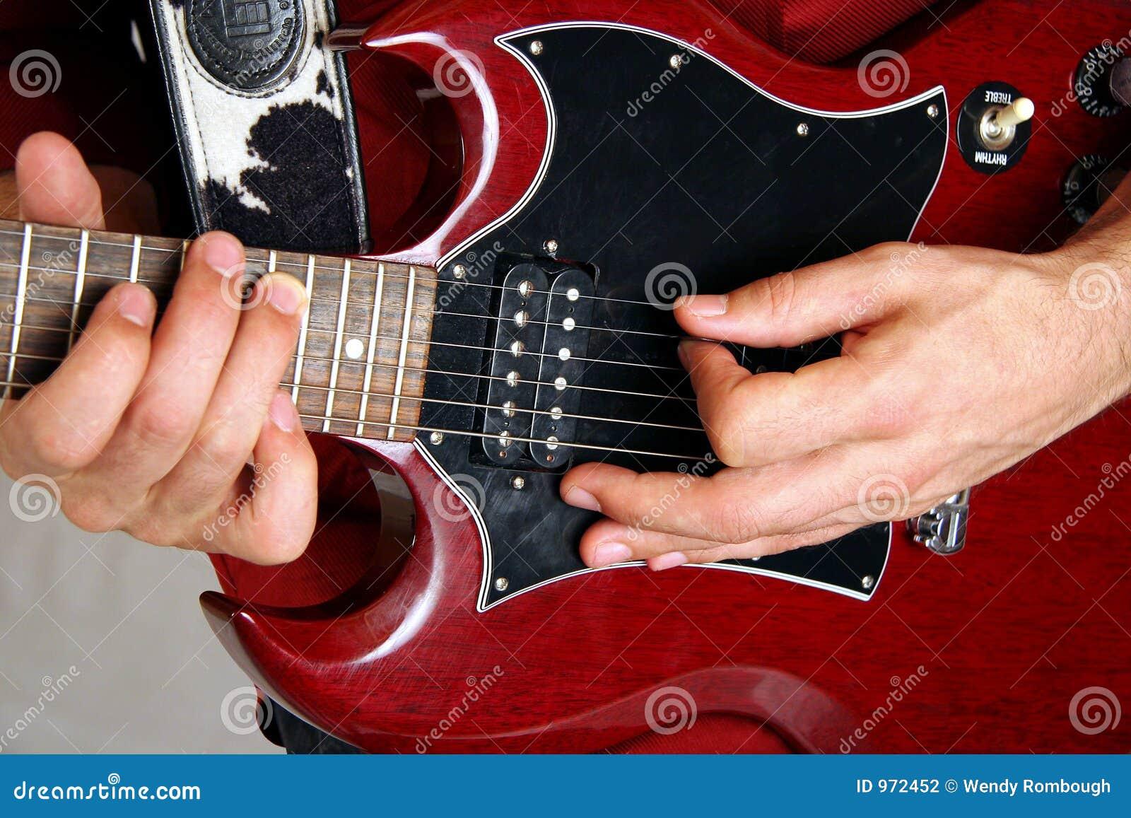guitare lectrique rouge et noire photographie stock. Black Bedroom Furniture Sets. Home Design Ideas