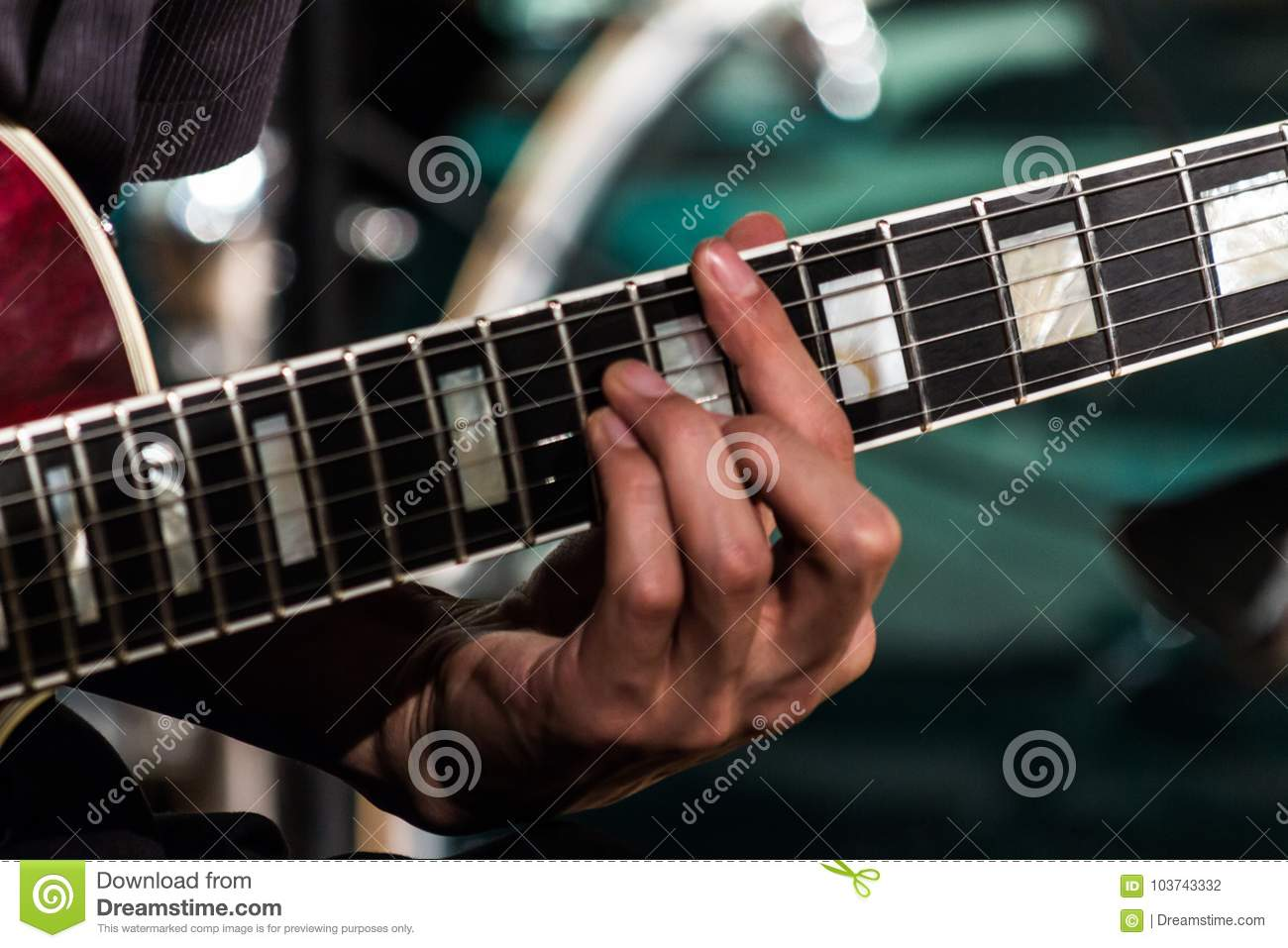 The Guitarist Clamped The Chord On The Electric Guitar Fretboard