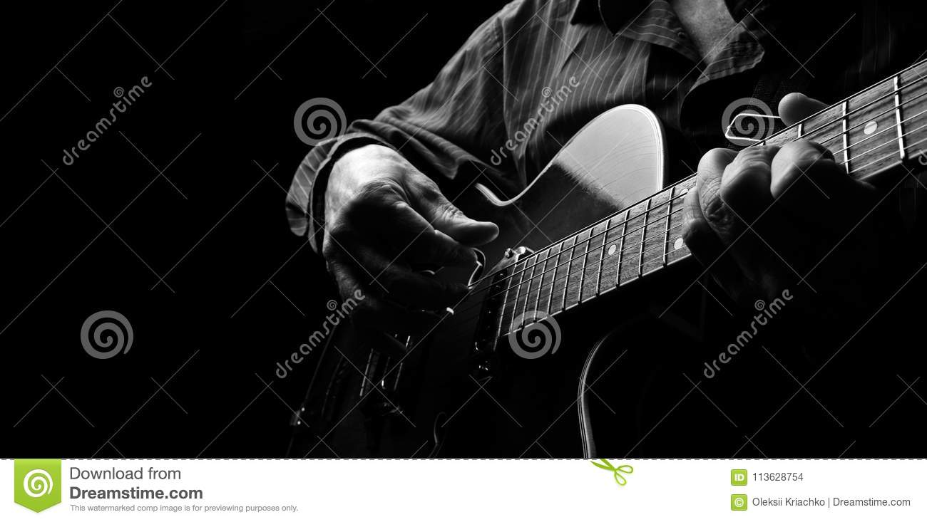 Guitarist hands and guitar close up. playing electric guitar. play the guitar. copy spaces.
