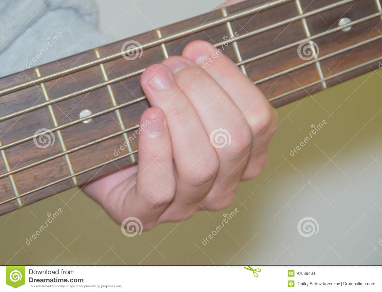 Guitarist Holding A Chord On The Strings Stock Photo Image Of