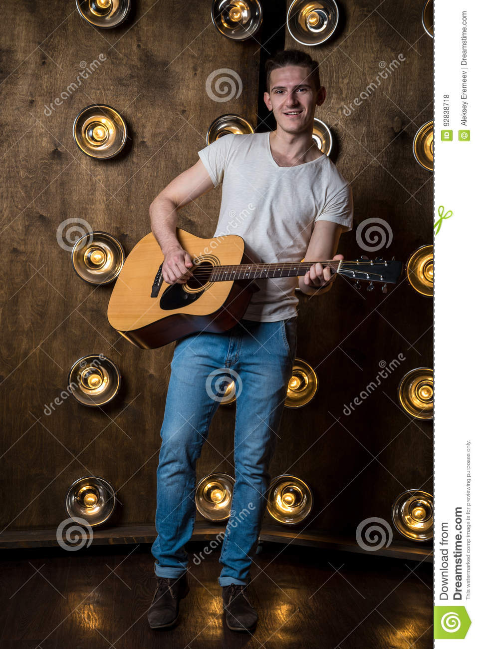 Guitarist, Music  A Young Man Plays An Acoustic Guitar On A