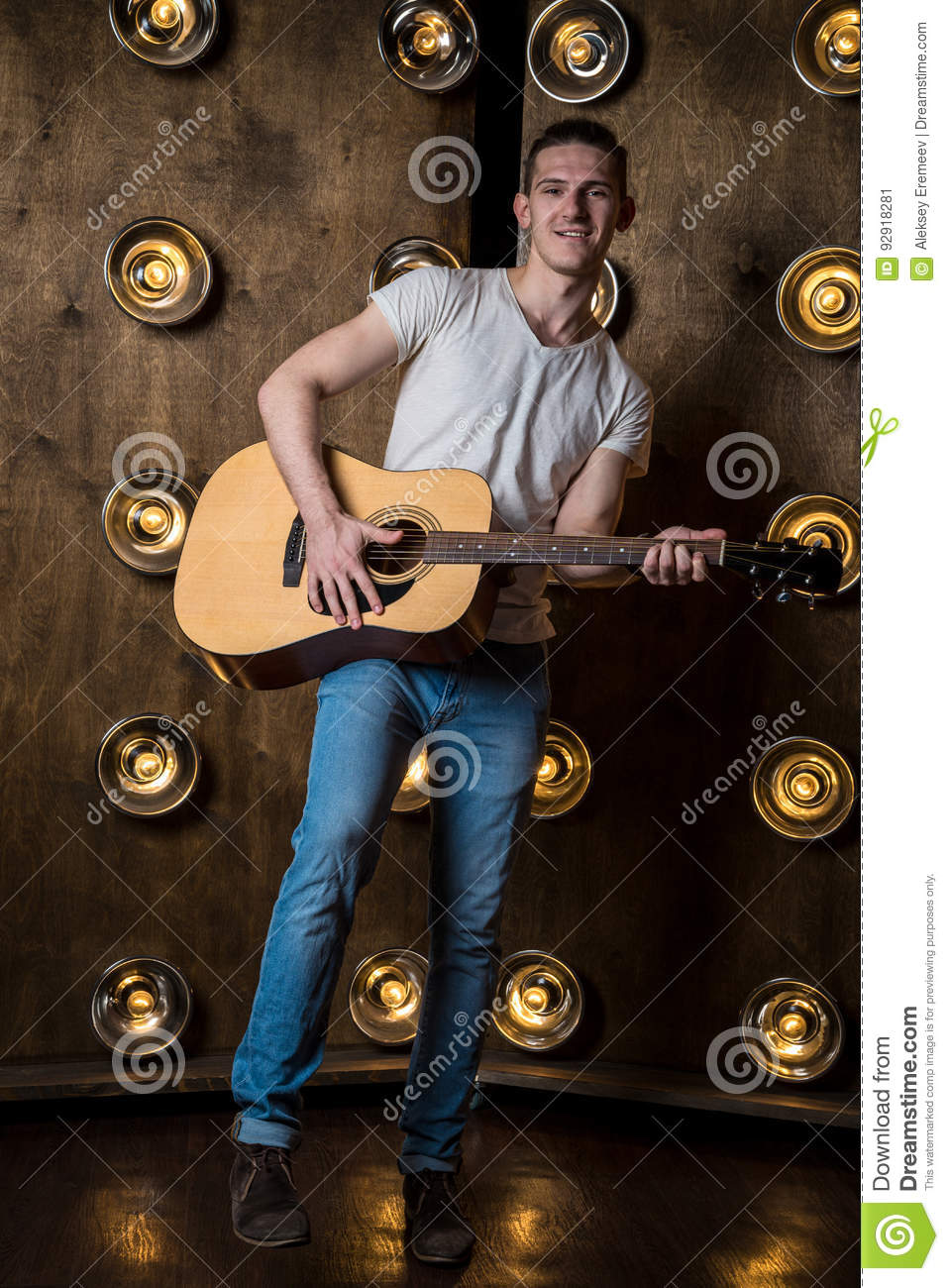 Guitarist, Music. A Young Man Plays An Acoustic Guitar On A ...