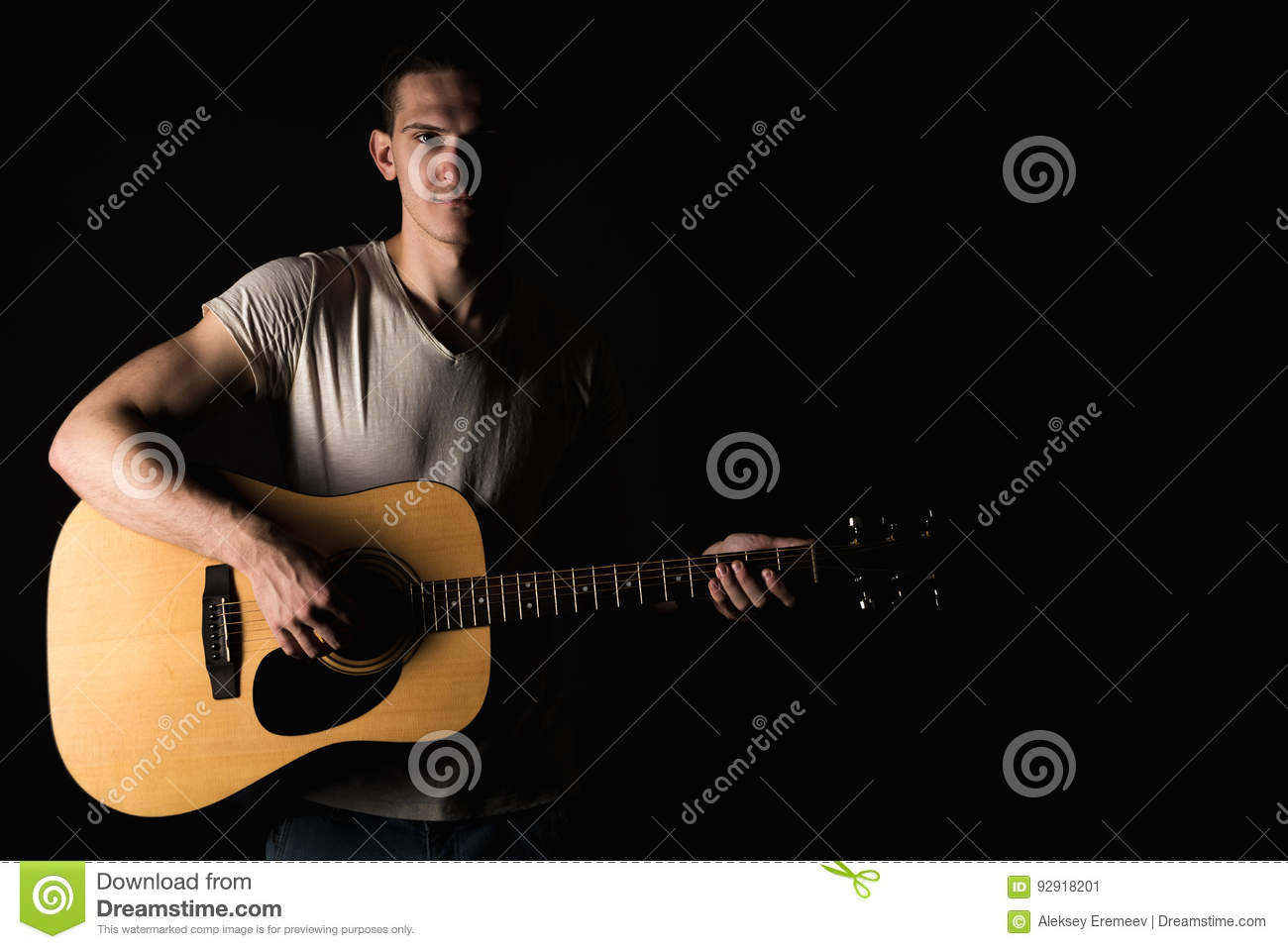 Guitarist, Music. A Young Man Plays An Acoustic Guitar On A Black ...