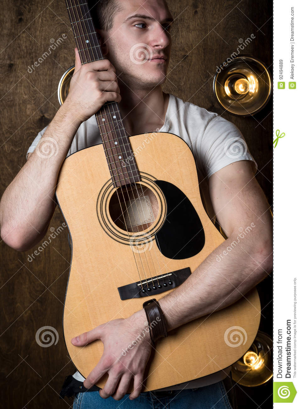 Guitarist, Music  A Young Man Stands With An Acoustic Guitar In The