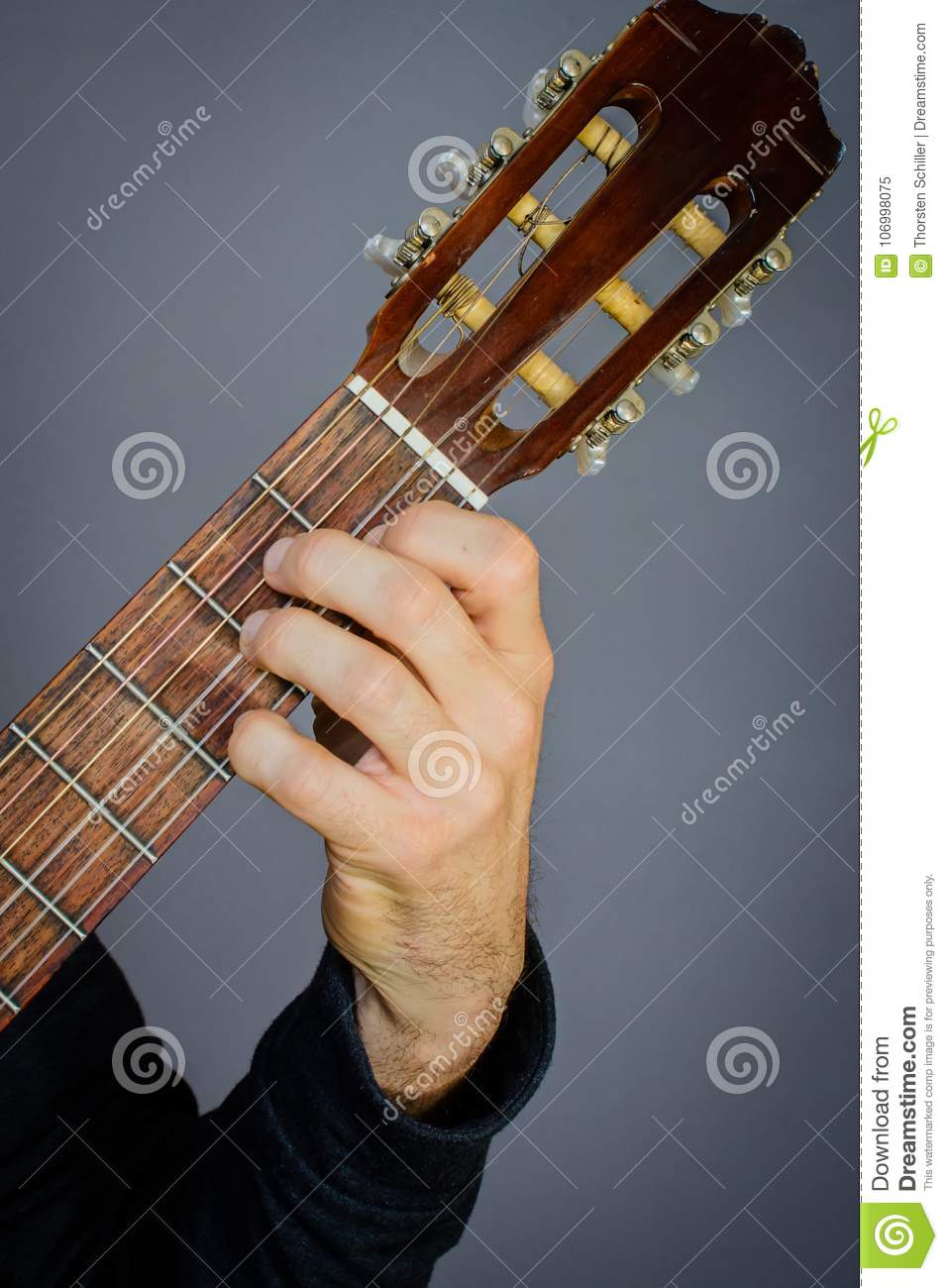 A Minor Chord Played By Guitarist On Classical Acoustic Guitar Stock