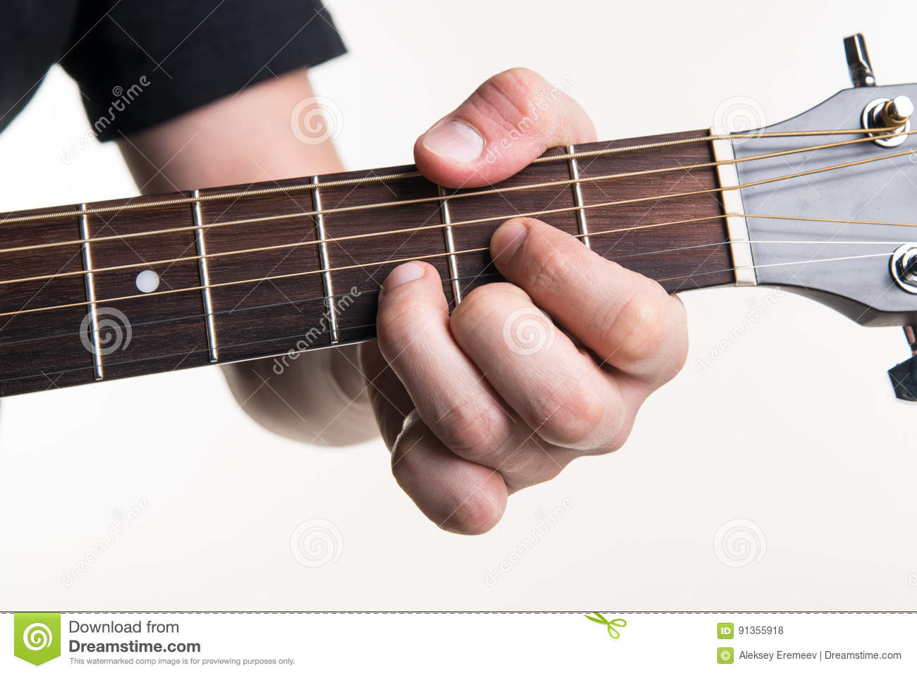 The Guitarists Hand Clamps The Chord D On The Guitar On A White