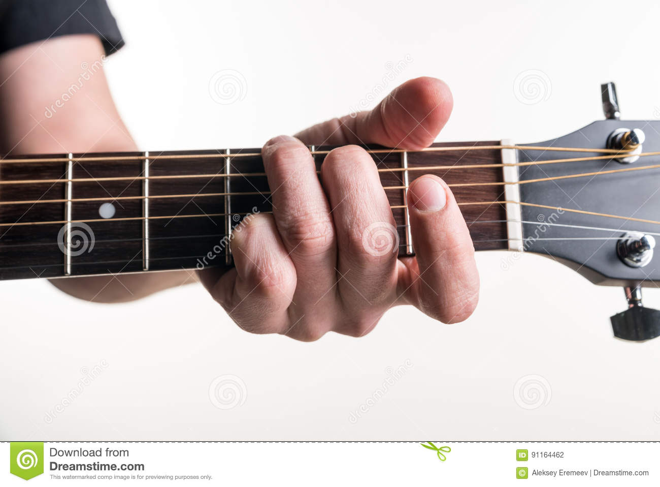 The Guitarists Hand Clamps The Chord G On The Guitar On A White