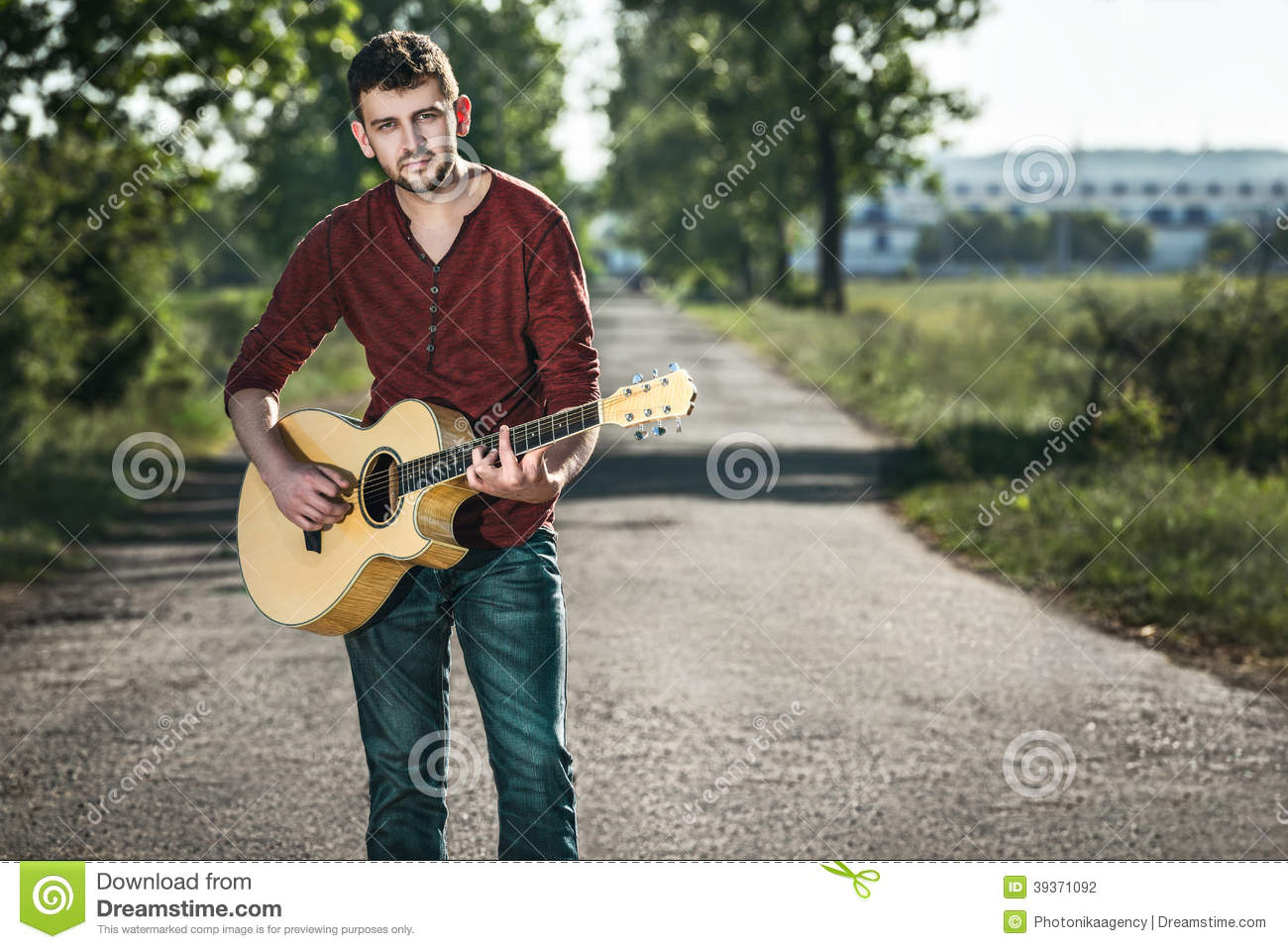 Guitarist singing on the road