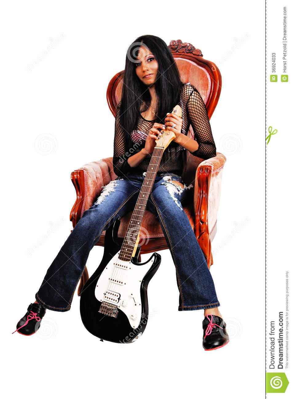 Guitarist sitting in armchair stock photos image 36924033 for Sitting in armchair