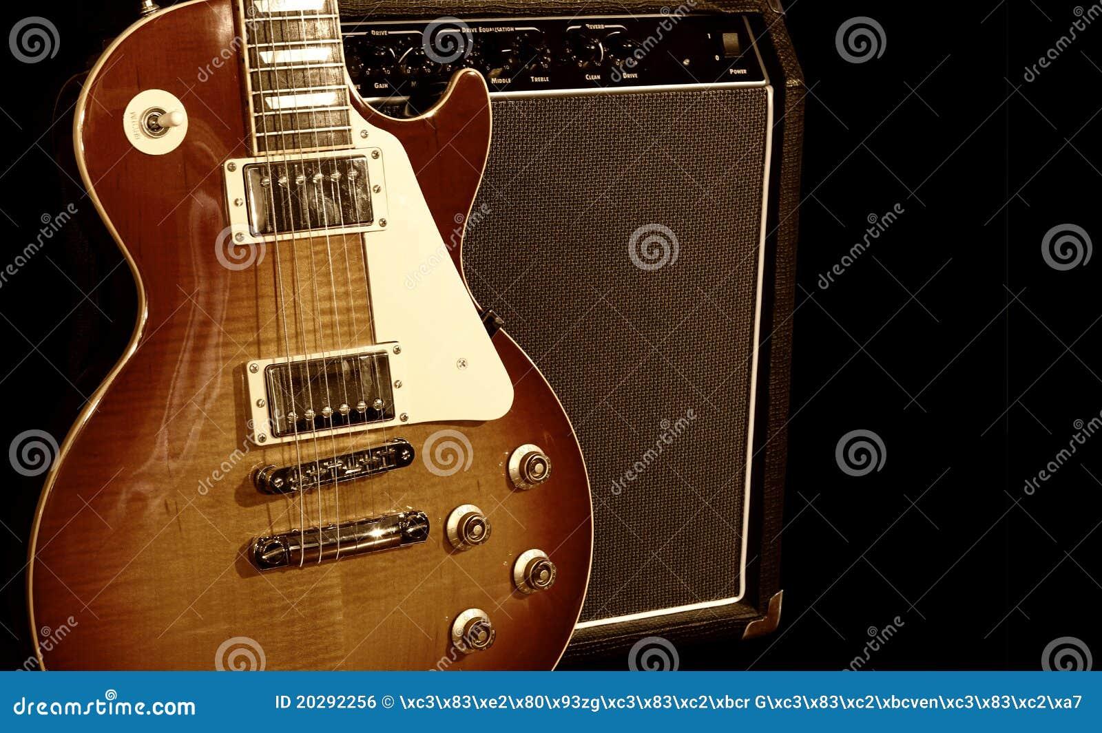 Guitarra eléctrica con el amplificador