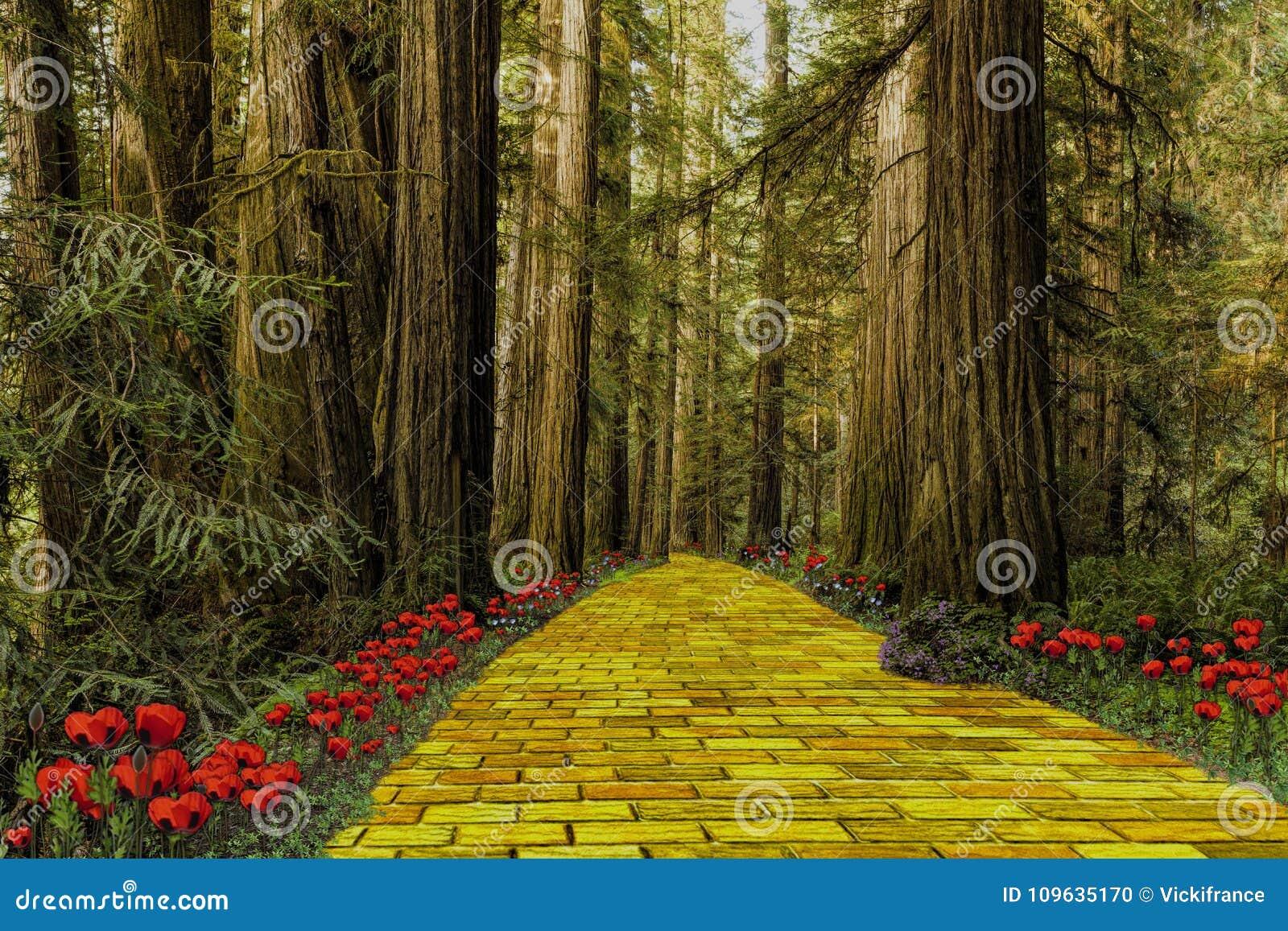 Gul tegelstenväg som leder till och med en skog