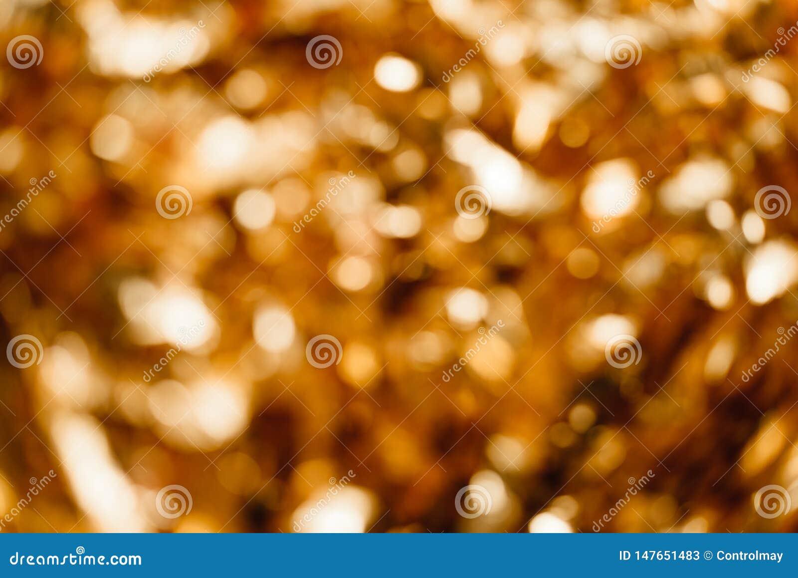 Guld- bakgrund ut ur fokus