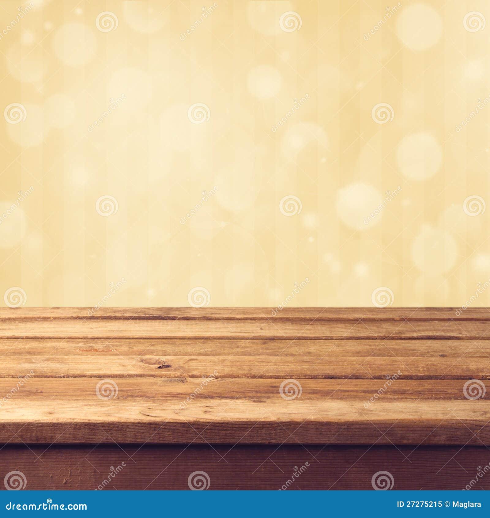 Guld- bokehbakgrund