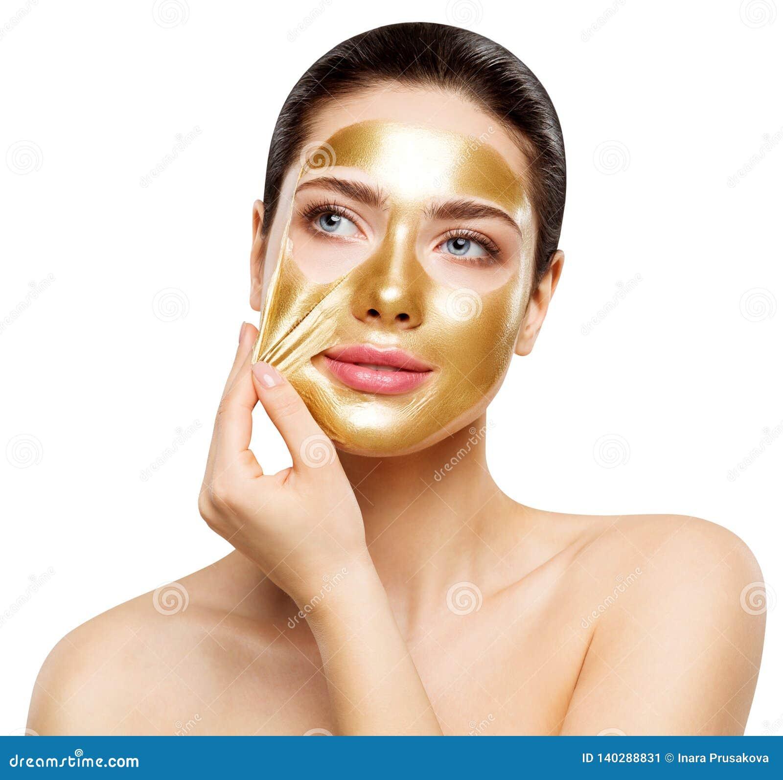 Guld- maskering för kvinna, härlig skönhetsmedel för modellRemoving Golden Facial hud, skönhet Skincare och behandling