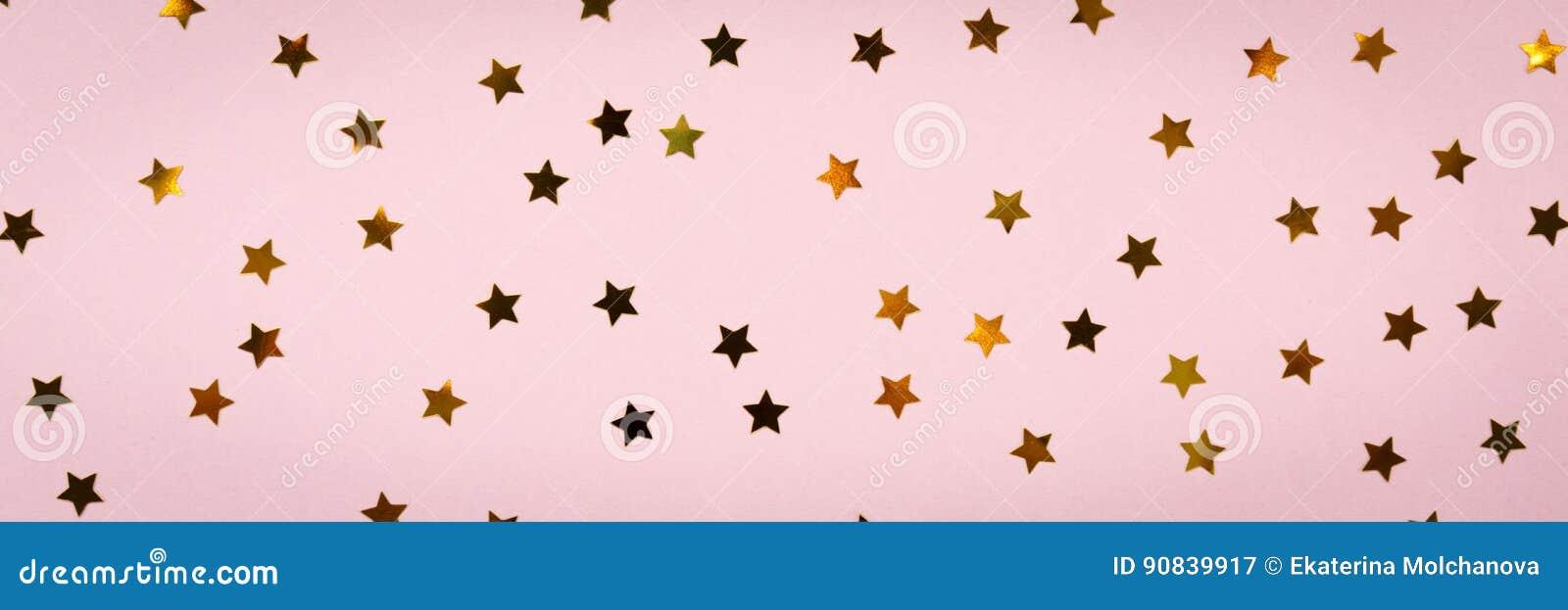 Guld- stjärnastänk på rosa färger festlig ferie för bakgrund celeb