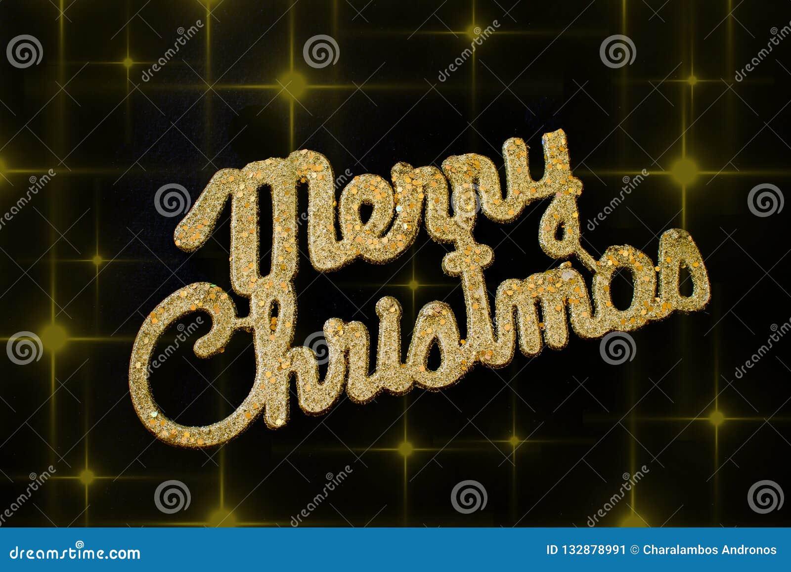 Guld- text för glad jul på en svart bakgrund med stjärnor